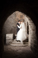 groom and the bride in interior of medieval castle