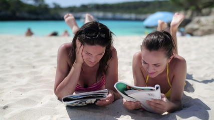 Image result for reading a magazine in beach