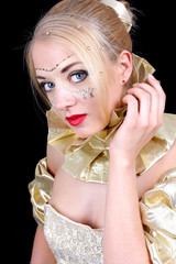 Beautiful woman with golden venetian mask