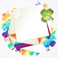 Sheet of paper and clover over colored background