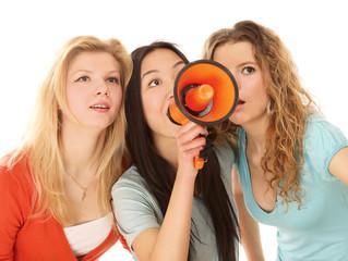Three yong girls making announcement
