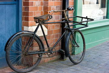 Old  Victorian Bicycle  Standing Outside A Shop Window.