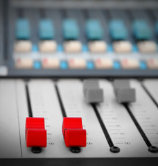 Close up of red audio sound mixer with buttons