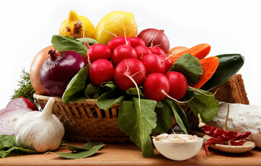 Healthy food. Fresh vegetables and fruits on a wooden board.