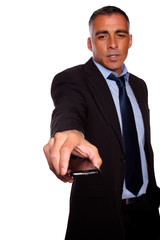 Charming business man offering a mobile phone