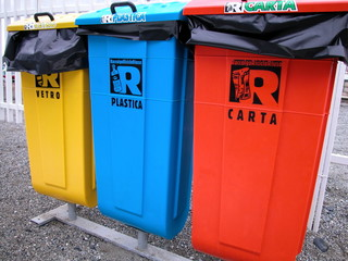 Three colorful recycling bin for cans, plastic and paper, Italy