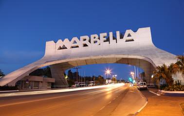 Marbella Arch illuminated at night. Andalusia, Spain