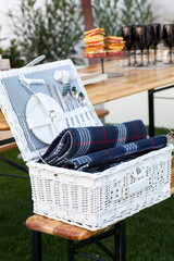 White Wicker basket with crockery and cutlery