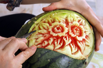 Woman s hands carved watermelon show step