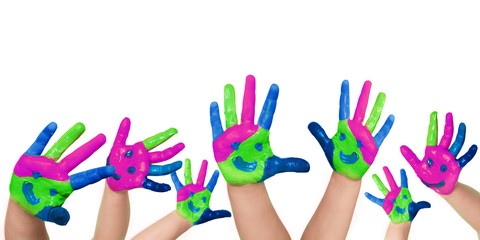 Many coloured child´s hand on white background