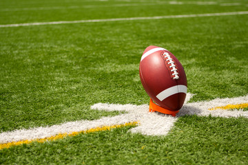 American Football teed up for kickoff