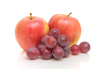 red apples and grapes on a white background