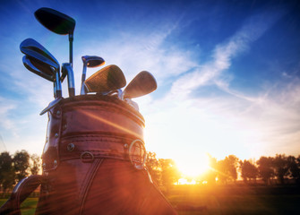 Poster Golf Golf gear, clubs at sunset on golf course