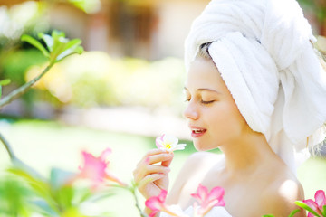 Beautiful woman and spring aromatherapy outdoors