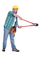 Construction worker using bolt cutting tool