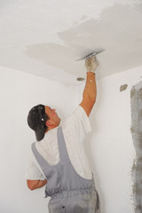 Construction worker painting walls