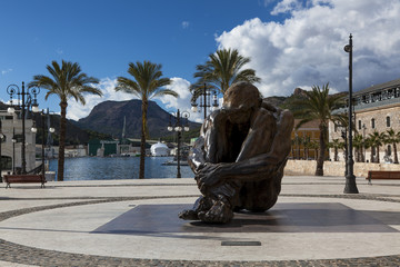 Cartagena harbour with large sculpture of a sitting man