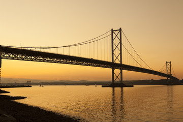 Forth road bridge at sunset in Scotland.