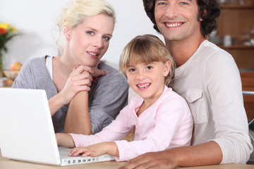 Parents teaching their child computer skills