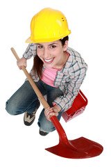 Female worker with a shovel