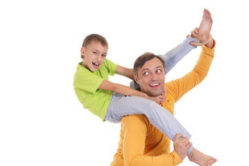 boy on his father shoulders