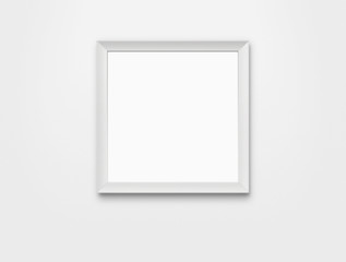Blank photo frame at the wall with clipping path
