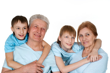Happy Caucasian grandparents with good children fooled