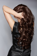 woman with long brown curly hair