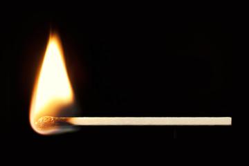 Burning Match Horizontal over Black