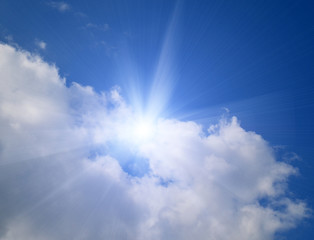 Background with blue sky,clouds and sun