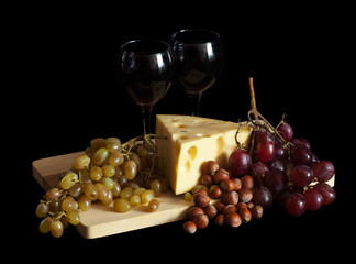 Grapes and cheese with glasses