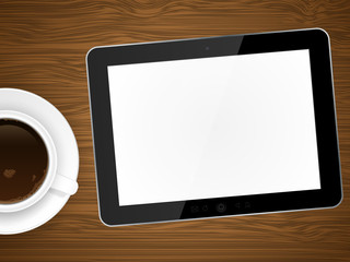 Coffee cap and tablet pc on wooden background.