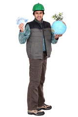 Construction worker standing with cash and a globe