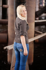 Young woman posing in industrial area