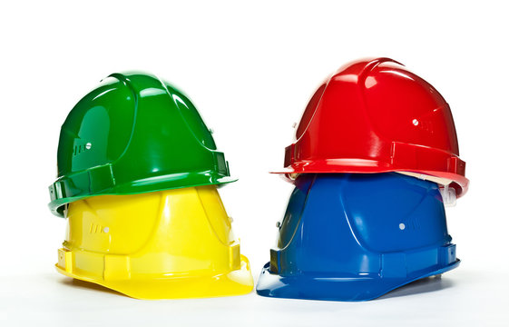 Industrial hardhats on white background