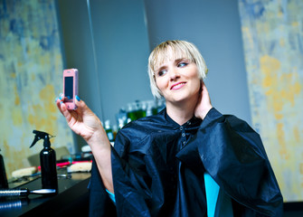 woman in hair salon photographing herself