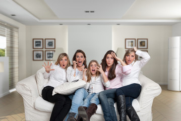 Girls in the family watching thriller