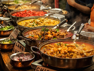 Oriental food - Indian takeaway at a London's market Wall mural