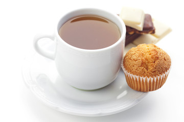 bar of chocolate,tea and muffin isolated on white