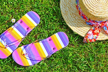 Colourful flip flops and a straw hat