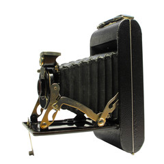 Antique camera on white background.