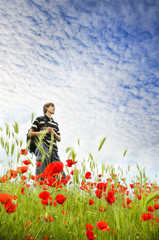 young man on poppy field.