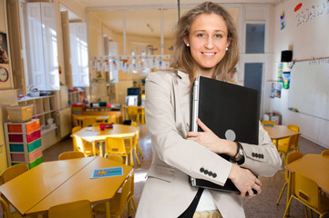 Young teacher holding a laptop
