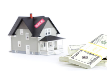 Real estate concept - bundles of dollars