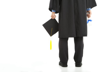 graduating  student holding diploma and cap
