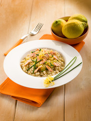 risotto with fresh salmon chive and lemon peel, healthy food