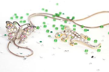 lizard brooch and butterfly brooch