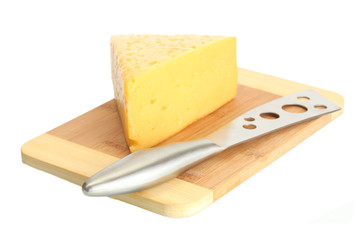 tasty cheese and knife on wooden cutting board isolated on
