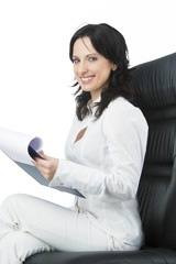 woman in business chair writing a doc and smiling with a natural
