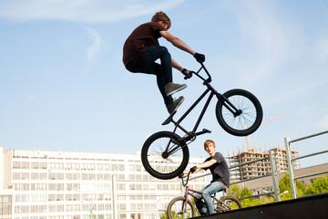 BMX bicycler over ramp